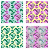 Set of vector seamless patterns with hearts. Symmetrical backgrounds. Polygonal design. Geometric triangular origami style, graphi Royalty Free Stock Images