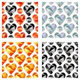 Set of vector seamless patterns with hearts. Symmetrical backgrounds. Polygonal design.  Stock Images