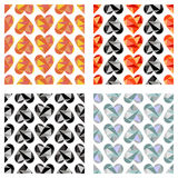 Set of vector seamless patterns with hearts. Symmetrical backgrounds. Polygonal design.  Royalty Free Stock Photography