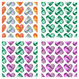 Set of vector seamless patterns with hearts.. Symmetrical backgrounds. Polygonal design. Geometric triangular origami style, graphic illustration. Series of Royalty Free Stock Image