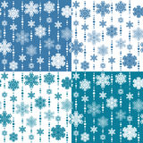 Set of vector seamless patterns with snowflakes. EPS10 Royalty Free Stock Photos