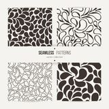 Set of vector seamless patterns of stylized leaves and petals Stock Image