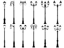 Set of vector silhouettes of lamppost. Set vector silhouettes of vintage artistic decorative lamppost, isolated on white Royalty Free Stock Photo