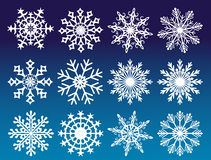 Set of vector snowflakes  on blue background. Royalty Free Stock Photo
