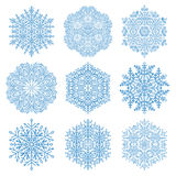 Set of Vector Snowflakes. Set of vector blue snowflakes. Fine winter ornament. Snowflakes collection. Snowflakes for backgrounds and designs Stock Images