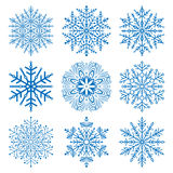 Set of vector snowflakes. Set of vector blue snowflakes. Fine winter ornament. Snowflake icons Stock Photos