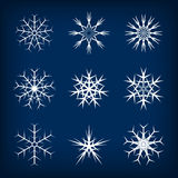 Set of vector snowflakes on dark blue background Royalty Free Stock Photos