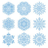 Set of vector snowflakes. Set of fine vector snowflakes. Light blue winter ornament. Snowflake icons Royalty Free Stock Photography
