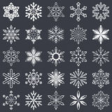 Set of vector snowflakes. Isolated on black background. Collection of 25 white snowflake shapes to use as brushes or design elements Stock Photos