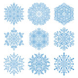 Set of Vector Snowflakes. Set of vector light blue snowflakes. Fine winter ornament. Snowflakes collection. Snowflakes for backgrounds and designs Stock Images