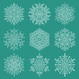 Set of Vector Snowflakes. Set of vector white snowflakes. Fine winter ornaments. Snowflakes collection. Snowflakes for backgrounds and designs Stock Photos