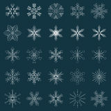 Set of vector snowflakes. Set of 25 white vector snowflakes on very dark blue background Stock Photo