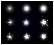 Set of Vector sparkling and glowing light effect stars Royalty Free Stock Image