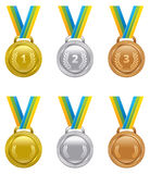 Set of vector sports awards gold, silver and bronze medals devot Royalty Free Stock Photos