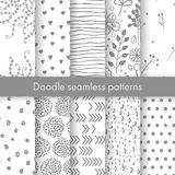 Set of vector spring patterns with flowers, doodle pattern, branches, leaves, dots, hearts. Gray and white colors. Seamless pattern is in the swatches palette Vector Illustration
