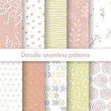 Set of vector spring patterns with flowers, doodle pattern, branches, leaves, dots, hearts. White, pink, yellow colors. Seamless pattern is in the swatches Royalty Free Illustration
