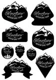 Set vector stylish retro badge templates with mountains and forests Royalty Free Stock Photos