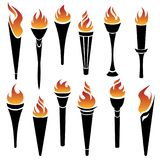 Flaming torches icons. Set of vector torch icons on white background for sports and peace concept design Royalty Free Stock Images