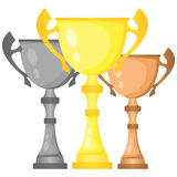 Set of vector trophy champion cups in gold, silver and bronze. Championship prizes for first, second and third place. Victory symbols isolated on white Stock Photography