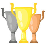 Set of vector trophy champion cups in gold, silver and bronze. Championship prizes for first, second and third place. Stock Photo