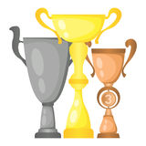 Set of vector trophy champion cups in gold, silver and bronze. Championship prizes for first, second and third place. Victory symbols isolated on white Stock Photos