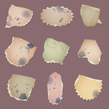 Set vector vintage dirty paper pieces with splats, fingerprints and cup circles Royalty Free Stock Photo