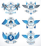 Set of vector vintage emblems created with decorative elements l Royalty Free Stock Image