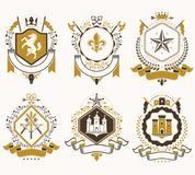 Set of vector vintage emblems created with decorative elements l. Ike crowns, stars, crosses, armory and animals.  Collection of heraldic coat of arms Stock Photography