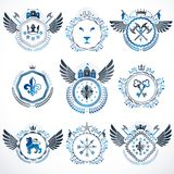 Set of vector vintage emblems created with decorative elements l. Ike crowns, stars, bird wings, armory and animals.  Collection of heraldic coat of arms Royalty Free Stock Photography
