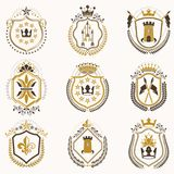 Set of vector vintage emblems created with decorative elements l. Ike crowns, stars, bird wings, armory and animals.  Collection of heraldic coat of arms Royalty Free Stock Image