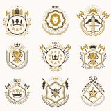 Set of vector vintage emblems created with decorative elements l. Ike crowns, stars, bird wings, armory and animals.  Collection of heraldic coat of arms Stock Photo