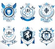 Set of vector vintage emblems created with decorative elements l. Ike crowns, stars, crosses, armory and animals.  Collection of heraldic coat of arms Royalty Free Stock Images