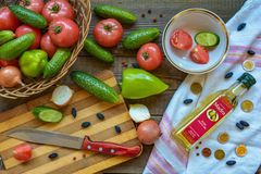 Set for vegetable salad: cucumbers, tomatoes, paprikas, onions, olive oil, seasonings Stock Photo