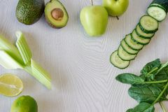 Set of vegetables and fruits for cooking green cocktail on a white wooden background, flat lay Stock Photography