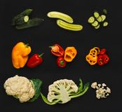 Collage of various vegetables on black background, isolated. Set of vegetables isolated on black background. Whole and cut cooking ingredients for sald or soup Royalty Free Stock Image