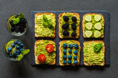 Set of vegetarian toast sandwiches with avocado and drinks. Variety of healthy food and drinks Royalty Free Stock Photography