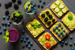 Set of vegetarian toast sandwiches with avocado and drinks. Variety of healthy food and drinks Stock Images