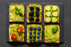 Set of vegetarian toast sandwiches with avocado. Variety of healthy food Stock Photo