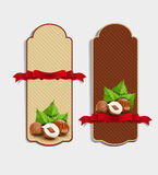 Set of vertical labels with hazelnuts and red ribbon (des Stock Images