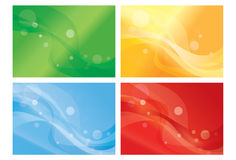 Set of vibrant wavy backgorunds. Set of four different vibrant dynamic wavy backgorunds in red , blue, green, and orange Royalty Free Stock Image