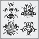 Set of viking labels, badges and emblems. Horned helmet, warrior, shield, sword and ax. Vintage style. Black and white Royalty Free Stock Photography