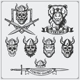 Set of viking labels, badges and emblems. Skull, horned helmet, warrior, shield, sword. Vintage style. Black and white Stock Photo