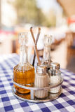 Set of vinegar and sauce, salt pepper on table at cafe Stock Images