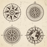Set of vintage antique wind rose nautical compass signs labels Stock Photos