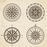 Set of vintage antique wind rose nautical compass signs labels royalty free illustration