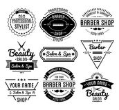 Set of vintage barber shop logo and beauty spa salon badges. Royalty Free Stock Photo