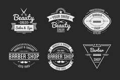 Set of vintage barber shop logo and beauty spa salon badges. Vector elements. Isolated icons on dark background Royalty Free Stock Image