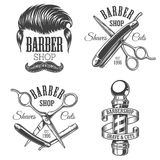 Set of vintage barbershop emblems. Labels, badges, logos. Layered. Text is on separate layer.  on white Royalty Free Stock Image
