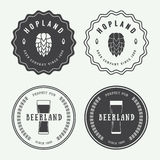 Set of vintage beer and pub logos, labels and emblems with bottl Stock Photography