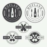 Set of vintage beer and pub logos, labels and emblems with bottles, hops, and wheat. Set of vintage beer and pub vector logos, labels and emblems with bottles stock illustration